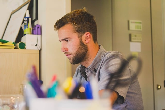 man working at something at a desk