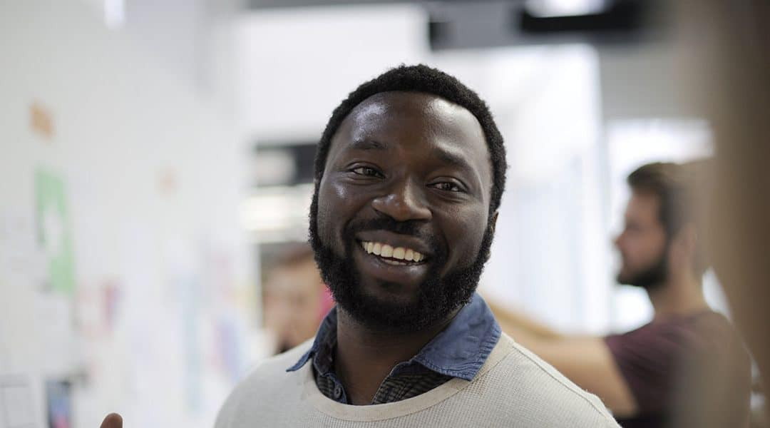 Photo of a man smiling towards the camera