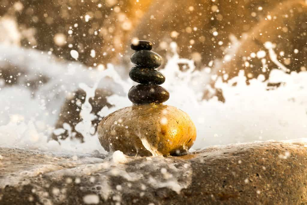 pile of stones in water.