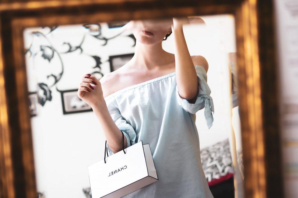 customer with Chanel bag